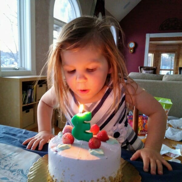 My grand-daughter Haddie. Blowing out the candle - celebrating her 3rd birthday.