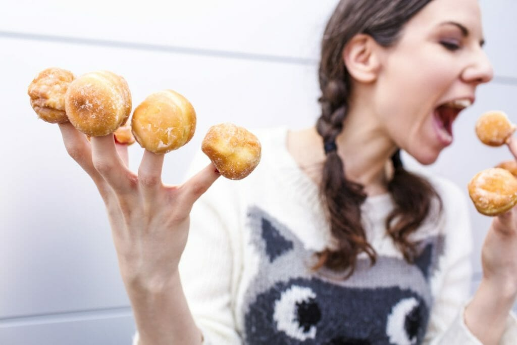 Lady with donuts on each finger. A free image - photo from gratisography. (A collection of free images.)