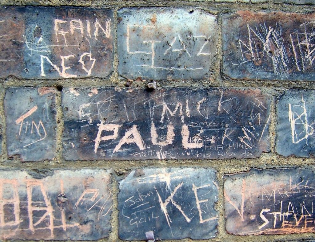 Names and words scratched on the surface of bricks. Millions of free images are available.