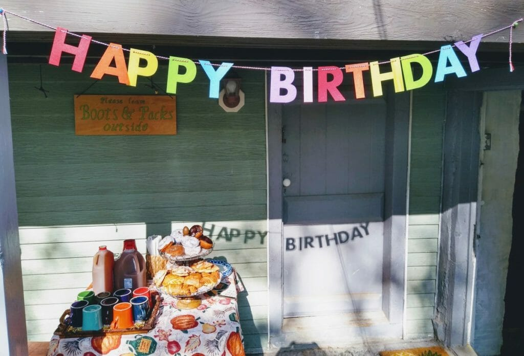 Happy Birthday sign hanging up for the celebration of Maple's 2nd birthday.