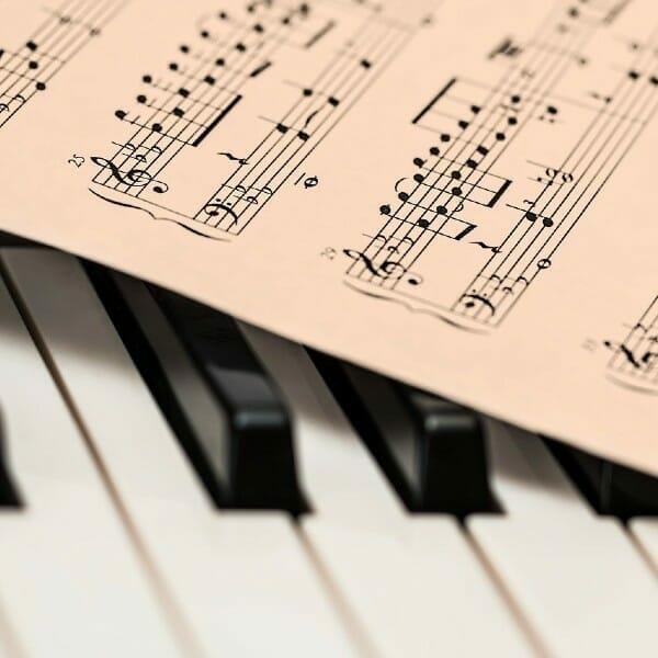 Musical score on piano keys.