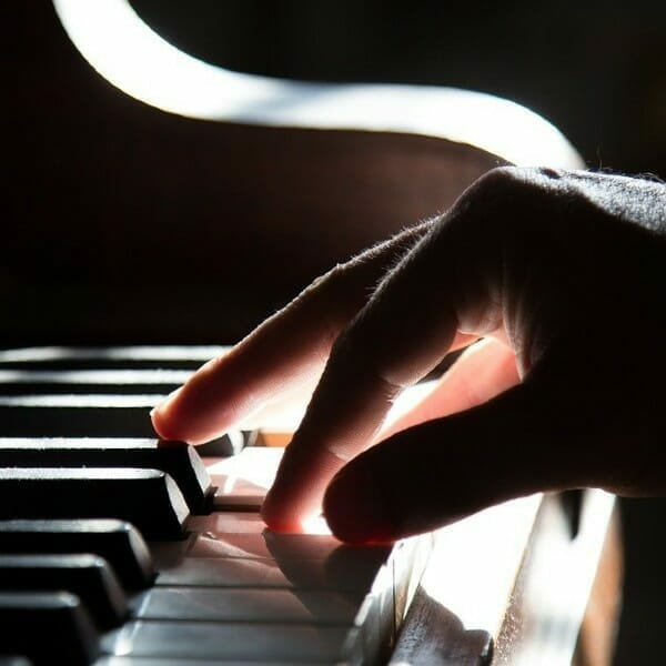 Right hand playing piano keys. Free images and free photos.