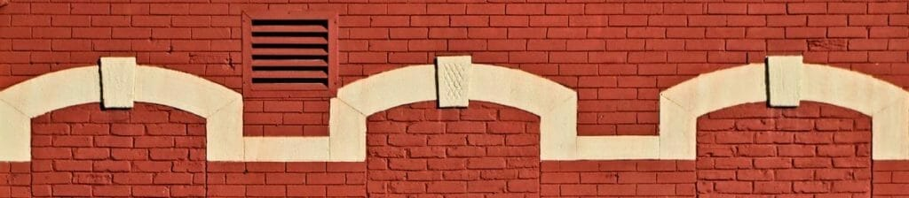 Keystone motif - Arches with keystone at the top.  Old windows have been removed and space filled in with red brick.