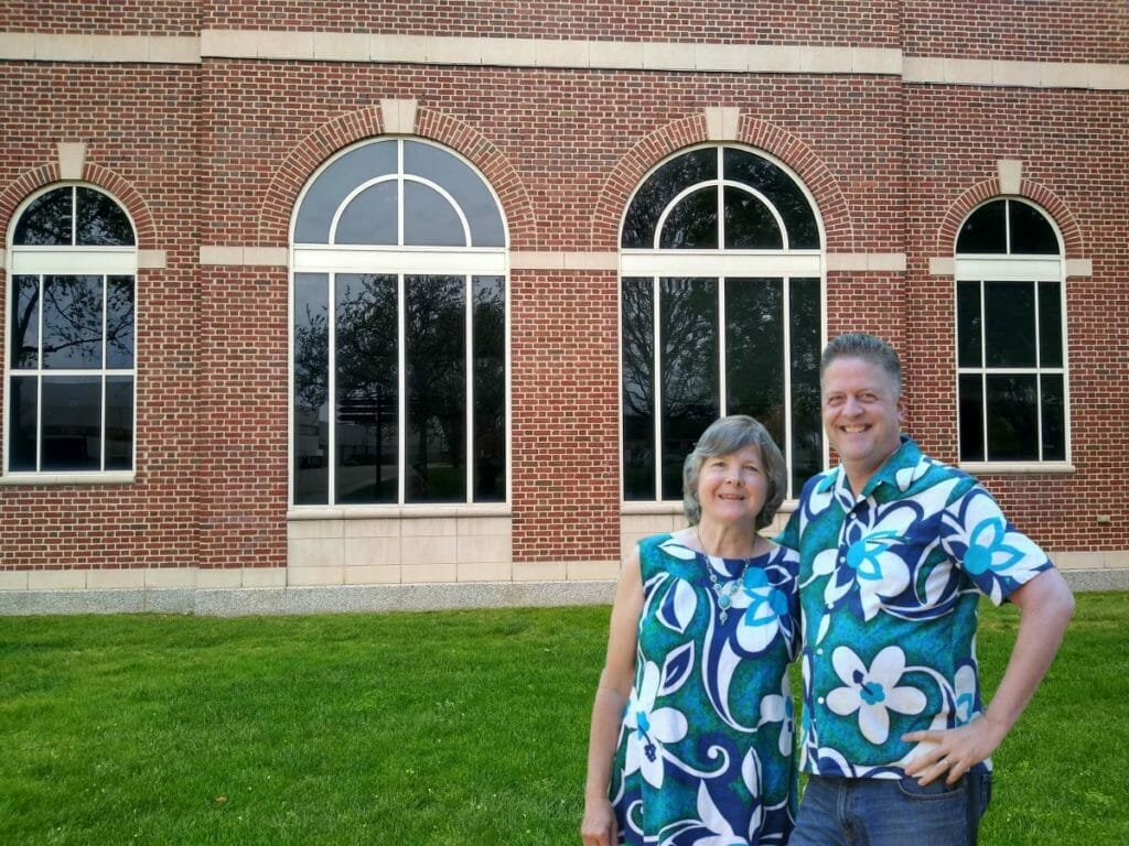 Jane and Doug Vos near the new, front entrance to the Henry Ford Museum in Dearborn, Michigan.