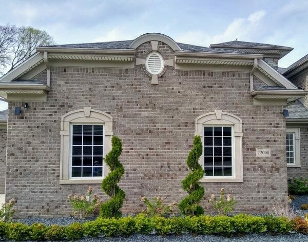Decorative keystone motif above windows on the garage of this home on Morley Street in Dearborn, Michigan.