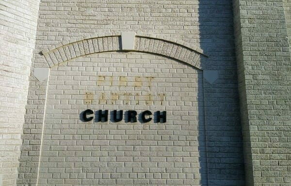 A decorative brick archway with keystone at the old First Baptist Church in Dearborn, Michigan.