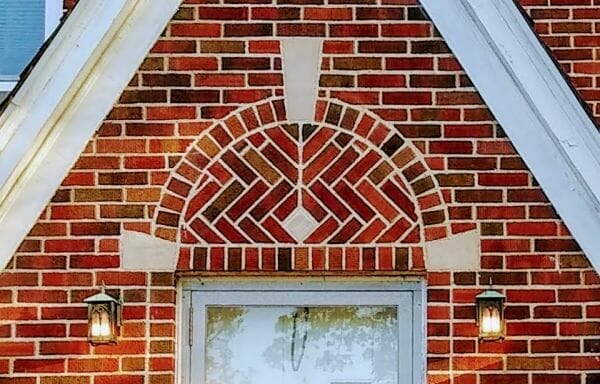 Keystone motif atop the brick archway above door on home in Dearborn, Michigan
